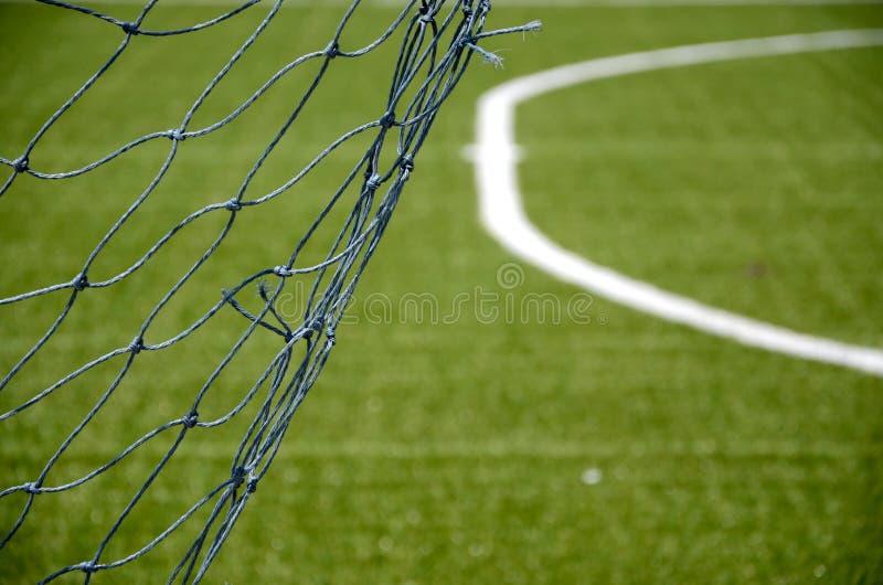 Net goal in soccer field stock image