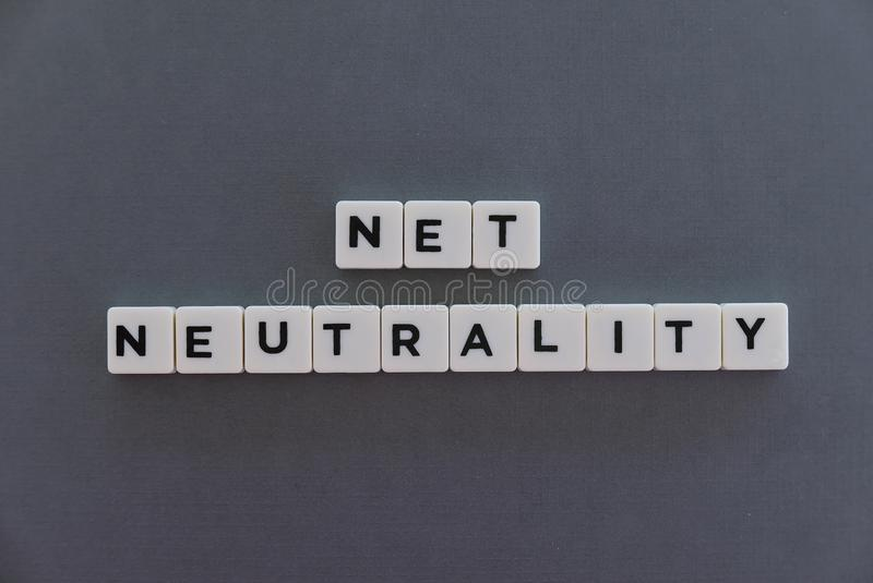 Net neutrality word made of square letter word on grey background. Internet freedom network politics provider concept policy equality technology traffic law stock photos