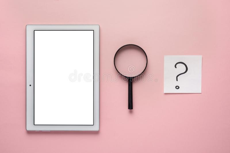 Net search. tablet with an isolated screen under the layout, magnifier and question mark on pink background. Net search. tablet with an isolated screen under the stock image