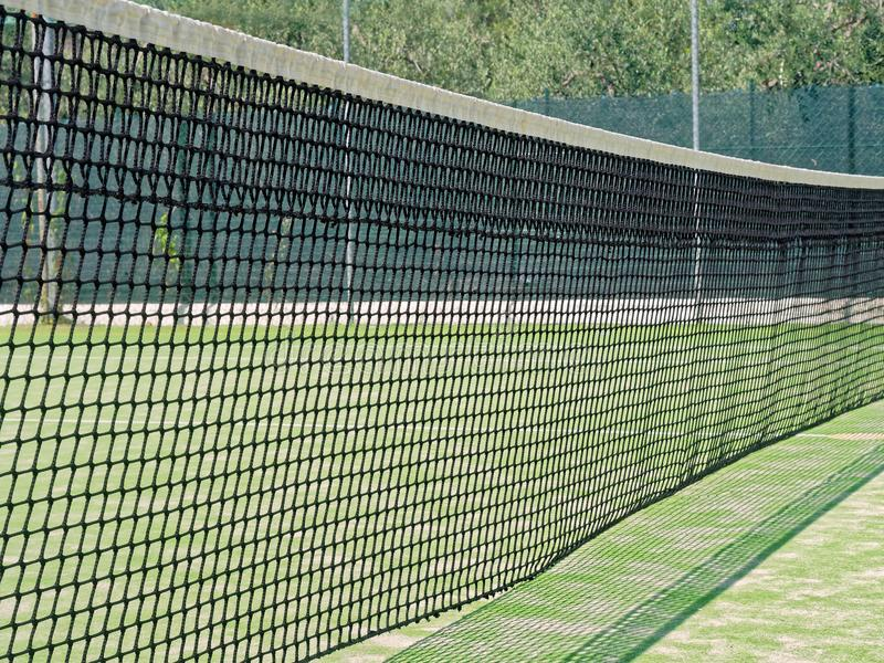 Net tennis field closeup royalty free stock photography