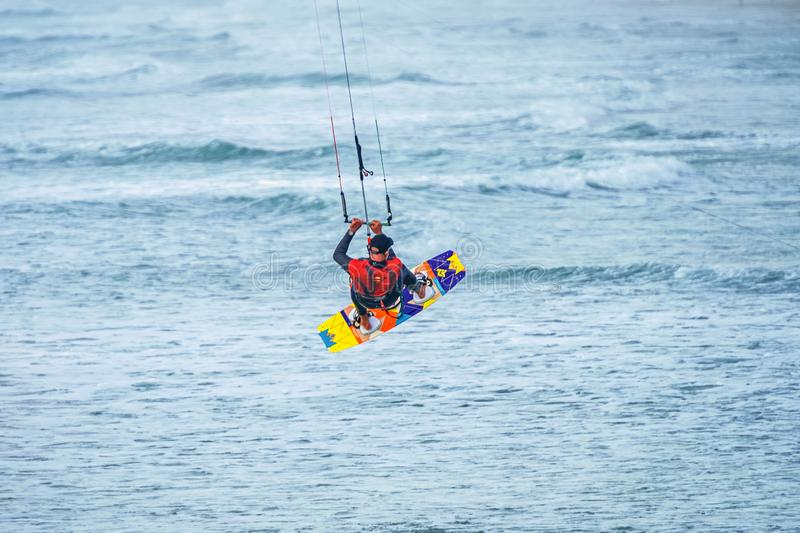 12/18/2018 Netanya, Israel, kitesurfing jumping over a surface of the Mediterranean sea. Over a parachute royalty free stock images