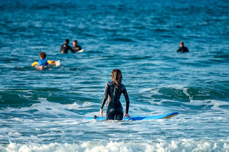 12/18/2018 Netanya, Israel, a surfer with a board goes swimming in the ocean at the dawn of the day. 12/18/2018 Netanya, Israel, a surfer with a board goes royalty free stock photo