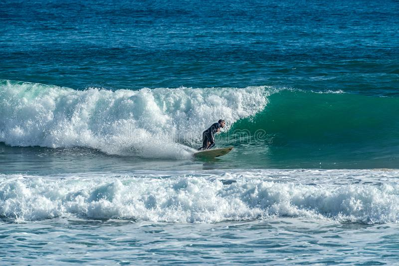 12/18/2018 Netanya, Israel, the surfer rides on the wave and perform tricks on a wave. At sunset stock photos