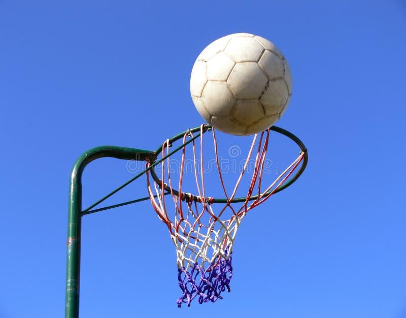 Netball basket and ball royalty free stock photo