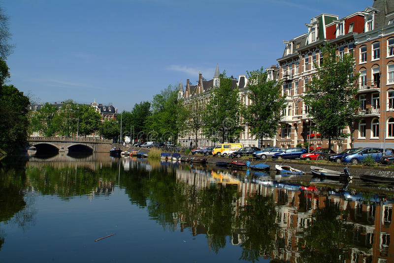Netherlands, Amsterdam. Netherlands, buildings and bridge at Singelgracht in Amsterdam stock photography