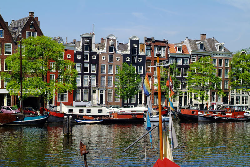Netherlands, Amsterdam. Buildings in traditional structure on Amstel river stock photography