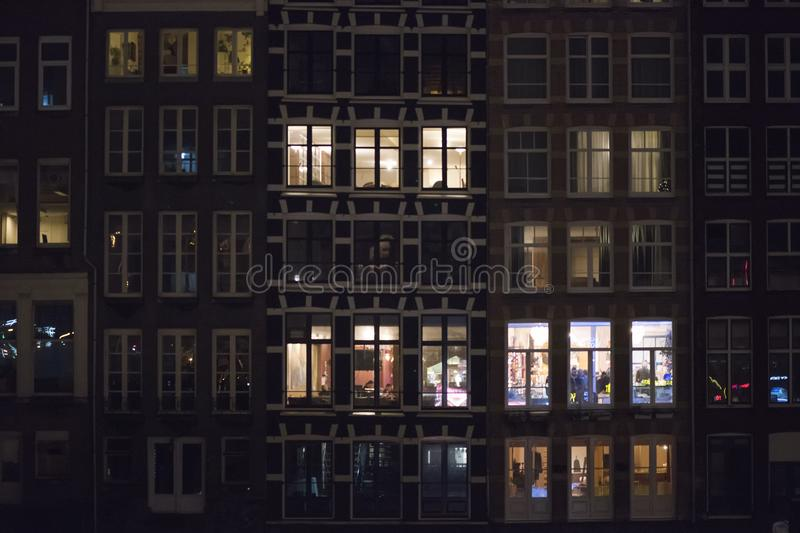Netherlands. Amsterdam.Night facade of houses in the city center.  royalty free stock photo
