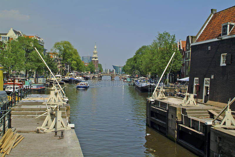 Netherlands, Amsterdam. Oide Schaans canal with view to Montelbaanstoren and Nemo Museum royalty free stock photo
