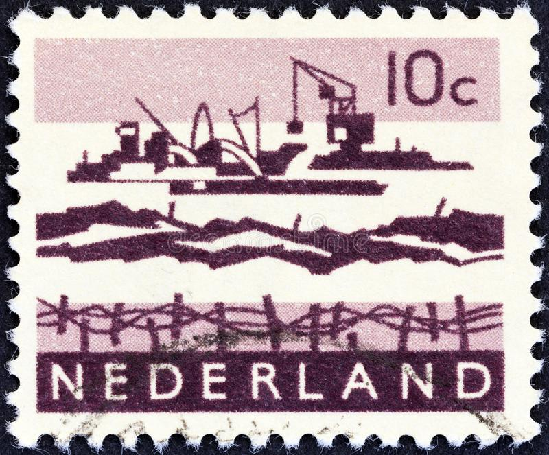 NETHERLANDS - CIRCA 1963: A stamp printed in the Netherlands shows Delta excavation works, circa 1963. royalty free stock images