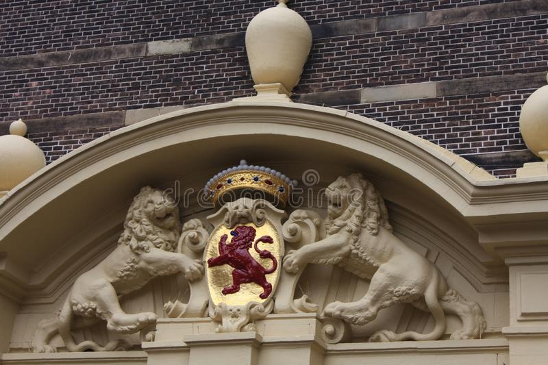 Netherlands emblem - Red lion at coat of arms in Hague city - the Netherlands royalty free stock photos