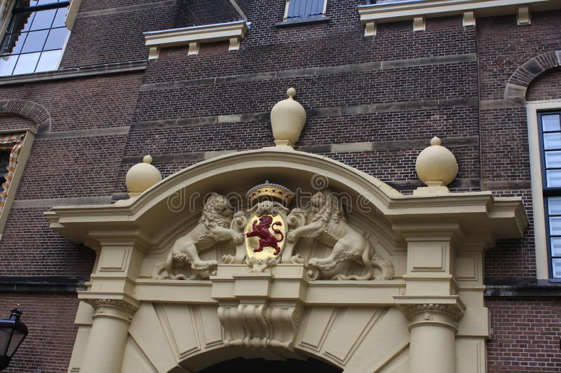 Netherlands emblem - Red lion at coat of arms in Hague city - the Netherlands stock images