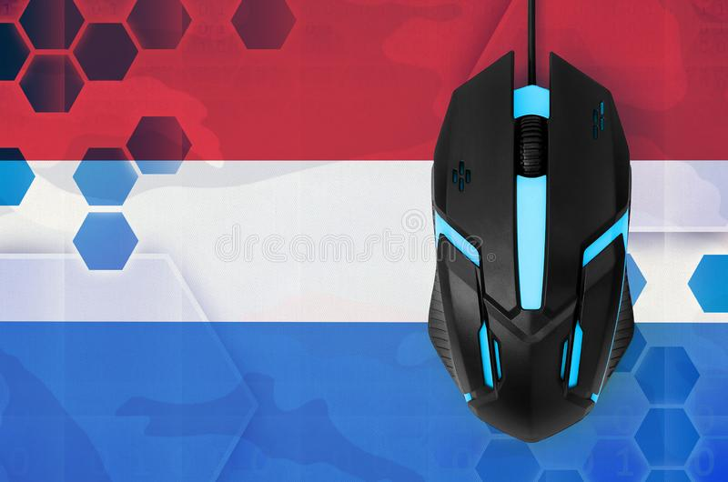 Netherlands flag and computer mouse. Concept of country representing e-sports team. Netherlands flag and modern backlit computer mouse. Concept of country royalty free stock images