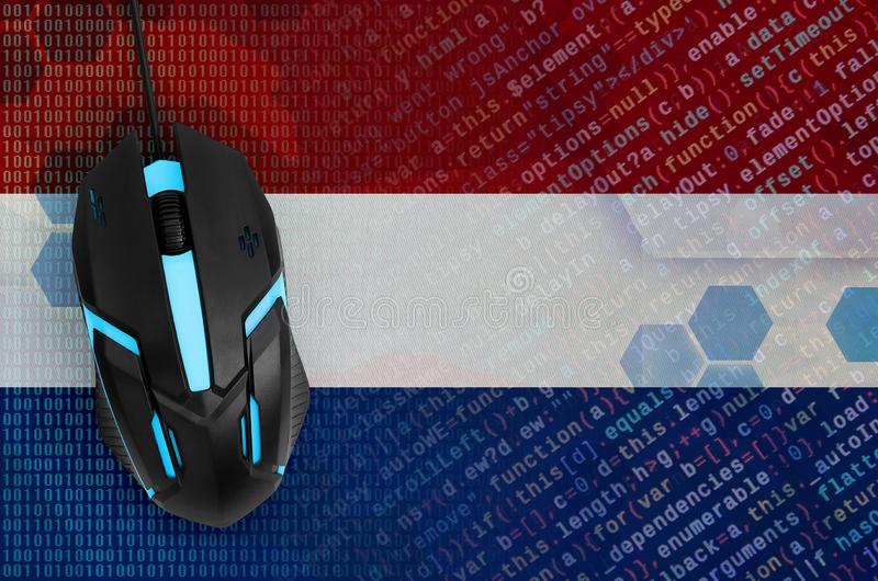 Netherlands flag and computer mouse. Digital threat, illegal actions on the Internet. Netherlands flag and modern backlit computer mouse. The concept of digital stock photography