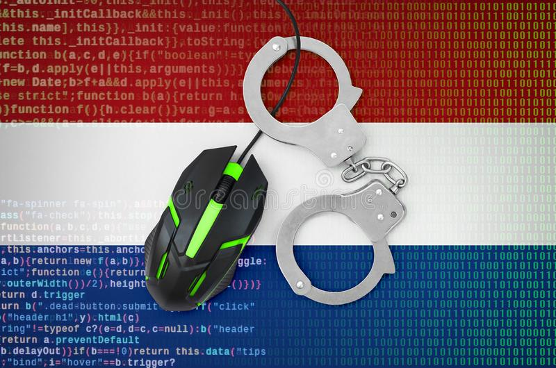 Netherlands flag and handcuffed computer mouse. Combating computer crime, hackers and piracy. Netherlands flag and handcuffed modern backlit computer mouse royalty free stock photos