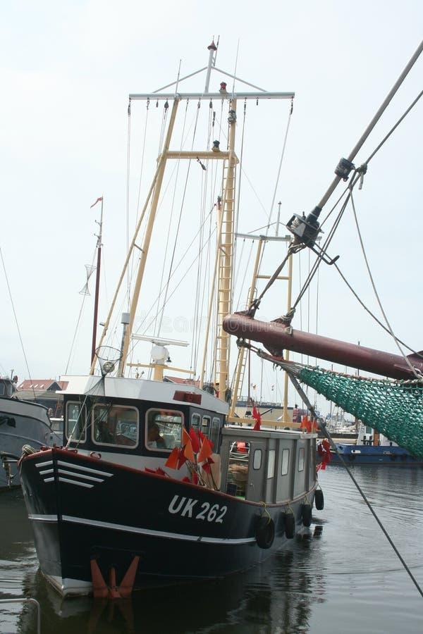 Fishing boat in de harbor of Urk. Netherlands,Flevoland,Urk,june 2017: Fishing boat in de harbor of Urk stock photos