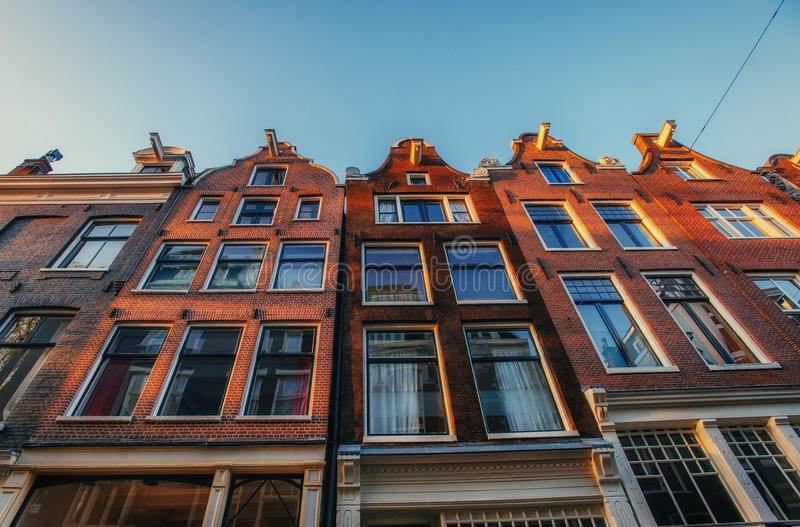 Netherlands .Istorychnyy center of Amsterdam. Big be. Autiful windows of houses stock images