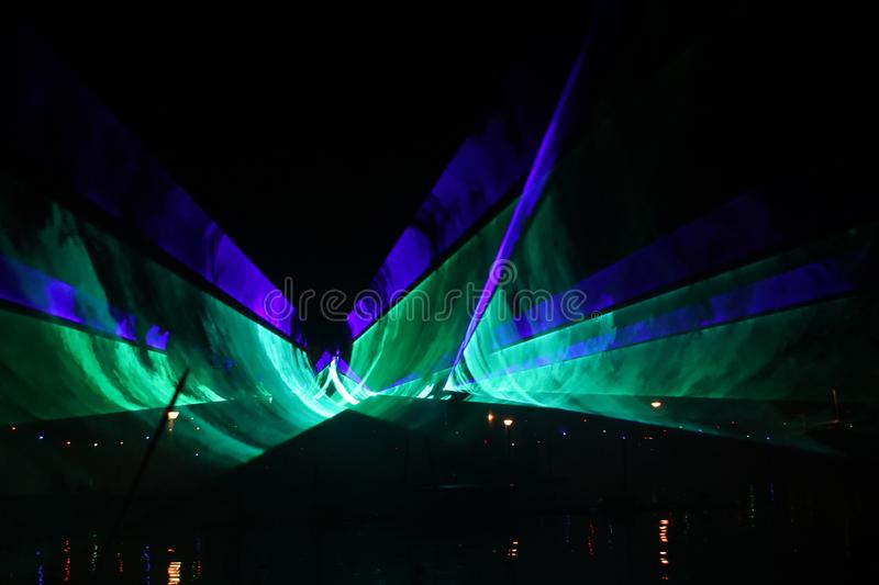 Laser show during public free event on public street and water with small ships parad royalty free stock photos