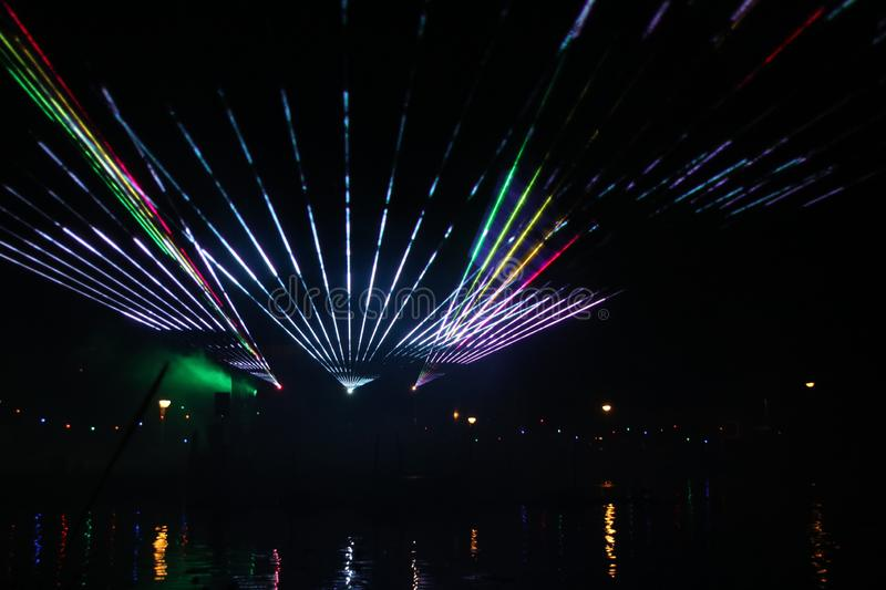 Laser show during public free event on public street and water with small ships parad royalty free stock photography