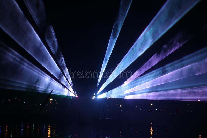 Laser show during public free event on public street and water with small ships parad stock photo