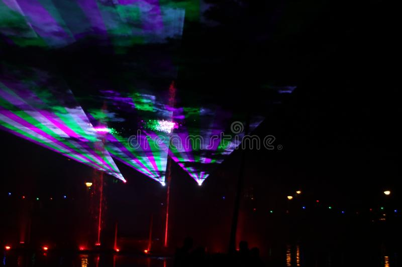 Laser show during public free event on public street and water with small ships parad royalty free stock image