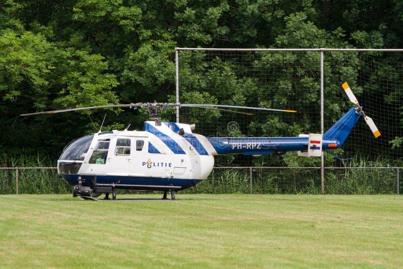 Netherlands Police helicopter Bo105. LEEUWARDEN, NETHERLANDS - JUNE 19, 2008: Netherlands Police Bo-105 helicopter on the sportfields of Leeuwarden airbase stock photography