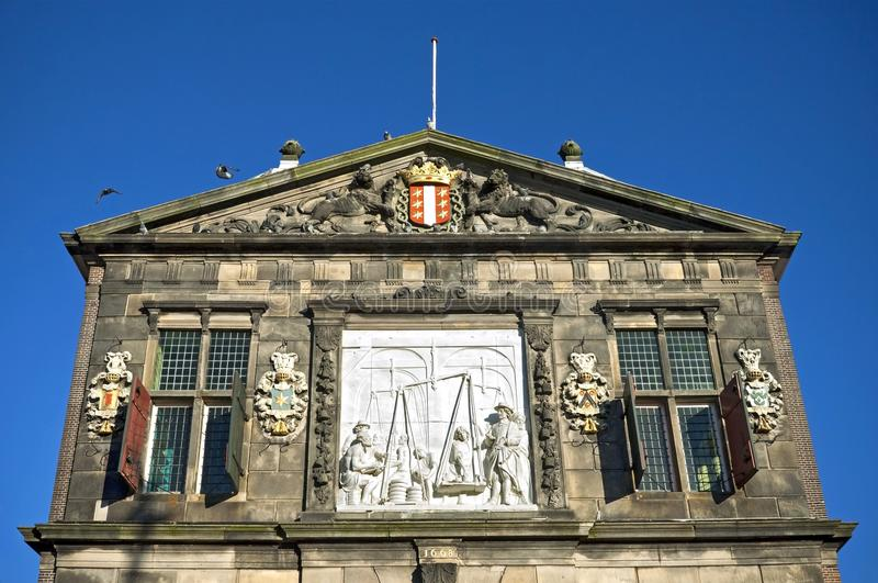 Artworks on ancient weighing house in Gouda royalty free stock image