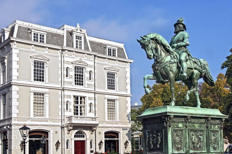 Statue William of Orange and old building The Hague royalty free stock photo
