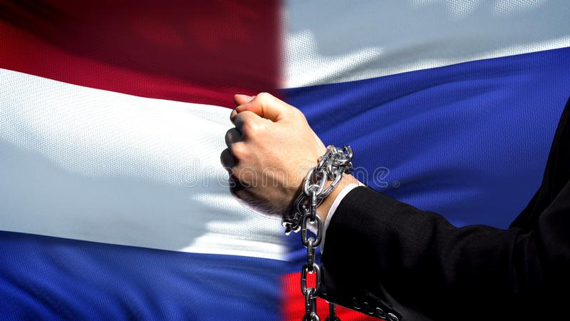 Netherlands sanctions Russia, chained arms, political or economic conflict stock photography