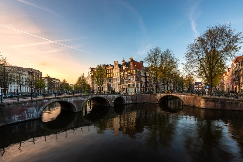 Netherlands traditional houses and Amsterdam canal in Amsterdam ,Netherlands.  stock photos