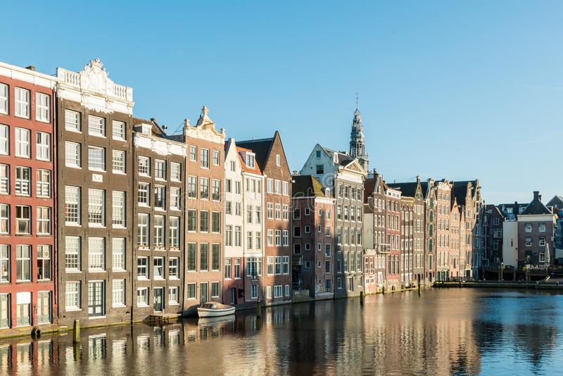 Netherlands traditional houses and Amsterdam canal in Amsterdam. Netherlands royalty free stock photo