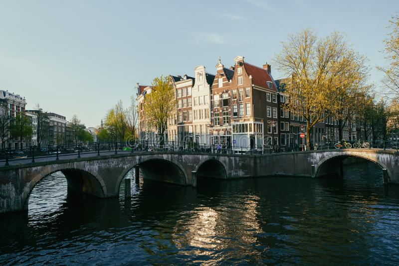 Netherlands traditional houses and Amsterdam canal in Amsterdam. Netherlands. Vintage tone stock photography