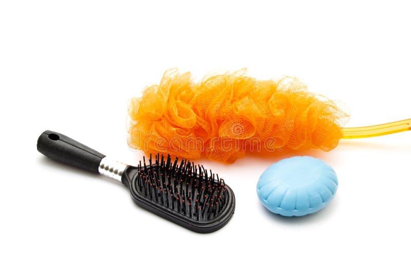 Netsponge com escova de cabelo e sabão fotos de stock