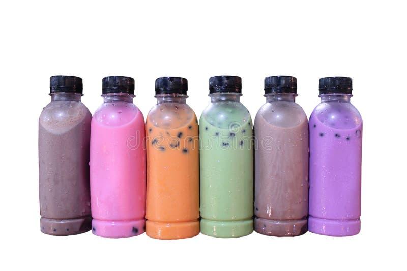Nettare multicolore in una bottiglia di plastica che sembra appetitosa immagini stock libere da diritti