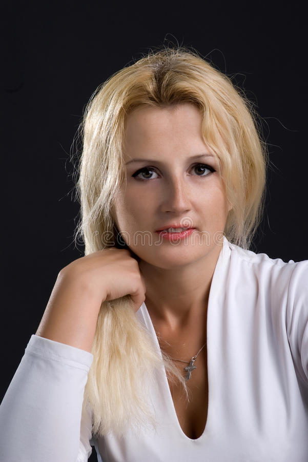 Nette blonde Frau stockfotografie