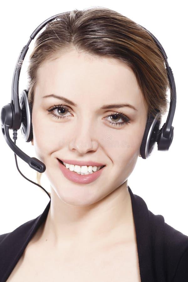Nette Geschäftsdame mit Kopfhörer stockfotografie