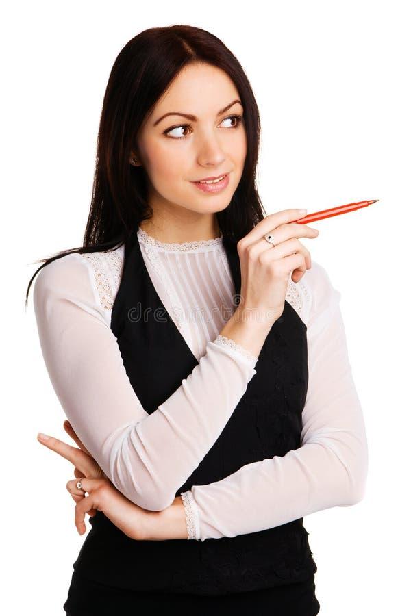 Nette Geschäftsfrau, die mit einer Markierung zeigt stockbild