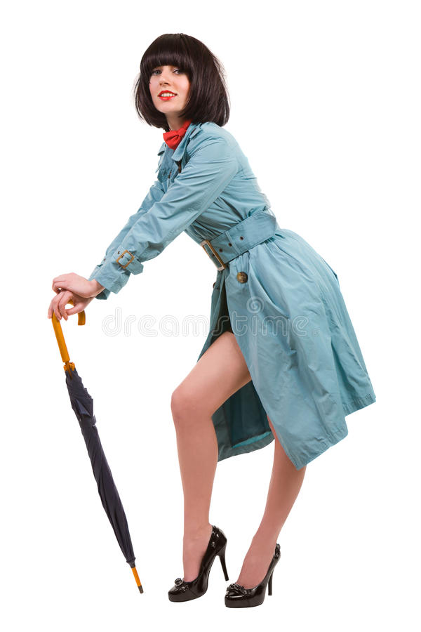 Nette junge Dame mit Regenschirm lizenzfreie stockbilder