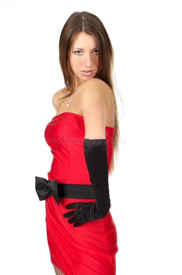 Nette junge Frau im Abendkleid stockbild