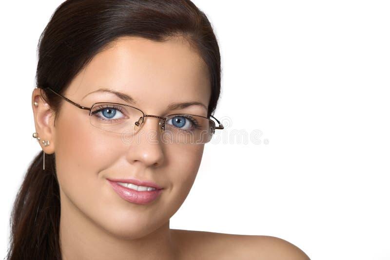 Nette junge Frau mit Gläsern stockbilder