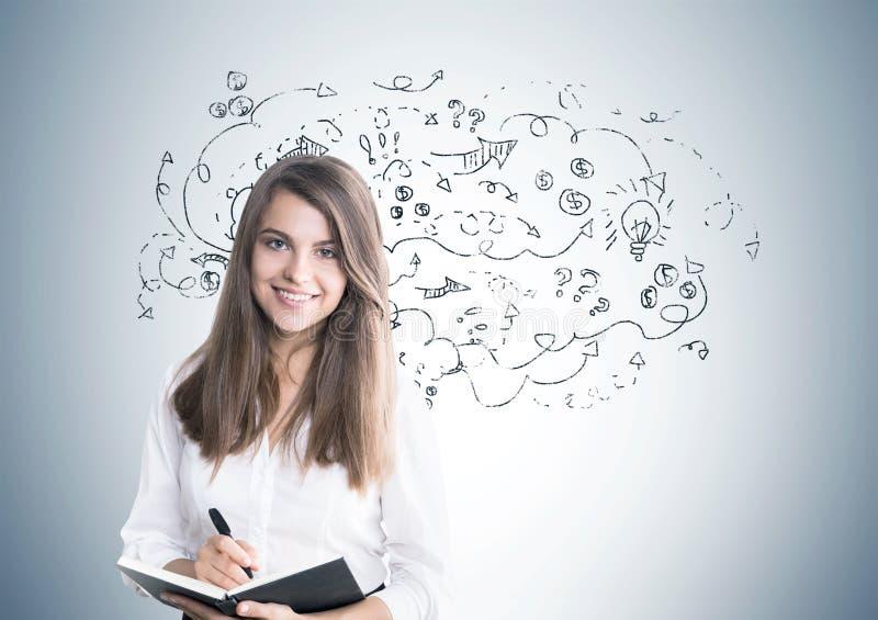 Nette junge Frau, Organisator, Pfeile stockbilder
