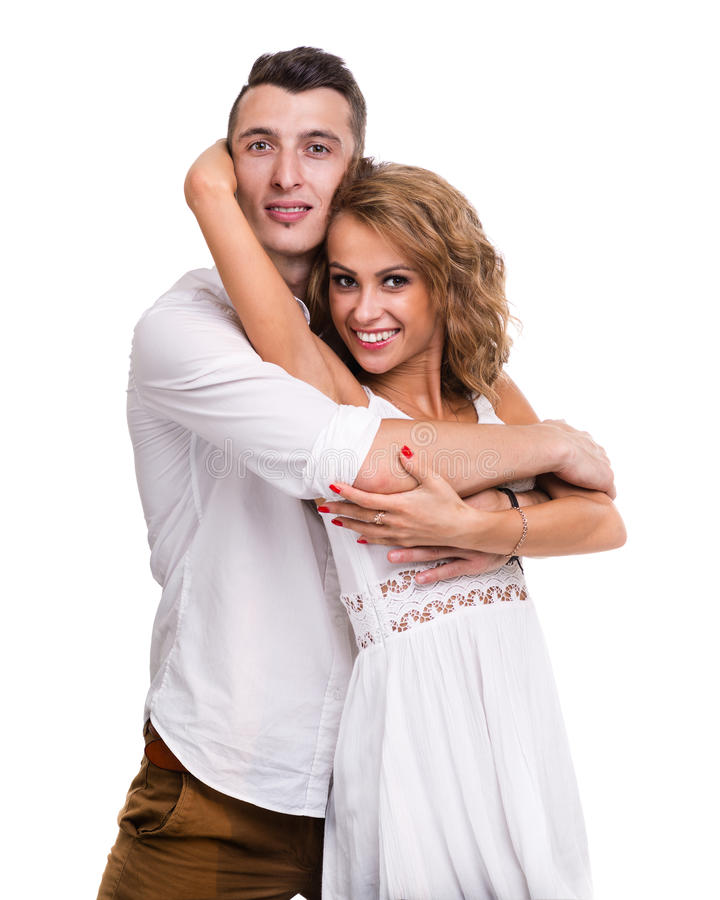 Nette junge Paare auf dem weißen Hintergrund, lokalisiert stockbilder
