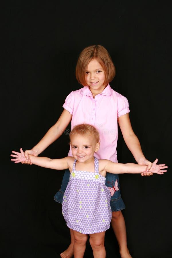 Nette Schwestern stockfotos