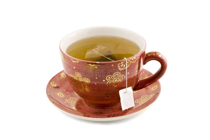 Nette Tasse Tee getrennt auf weißem Hintergrund lizenzfreie stockfotos