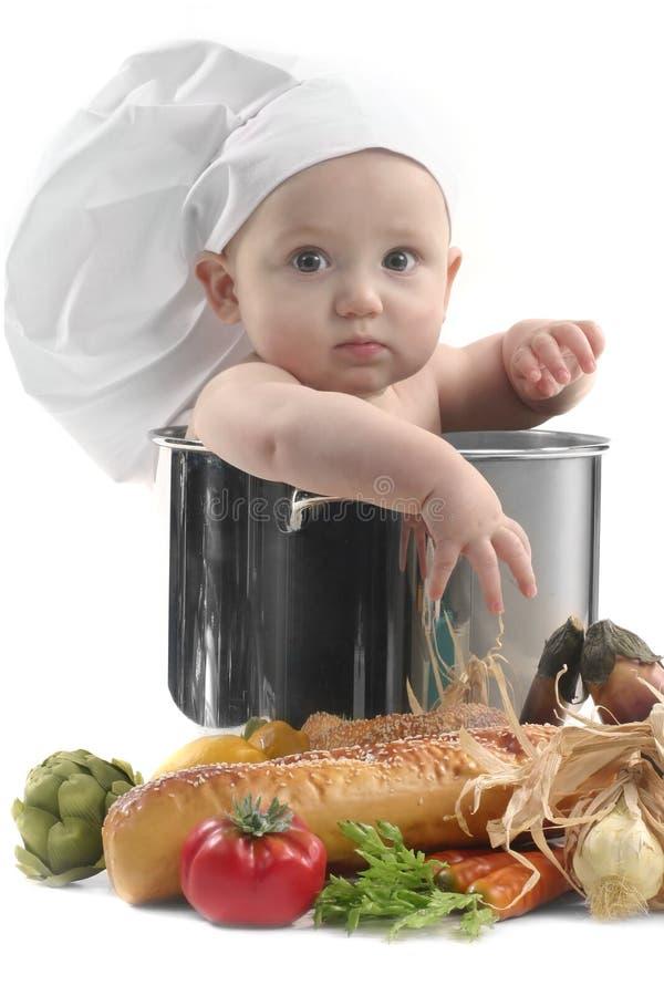 Netter Chubby Schätzchen-Chef in einem kochenden Potenziometer lizenzfreie stockbilder