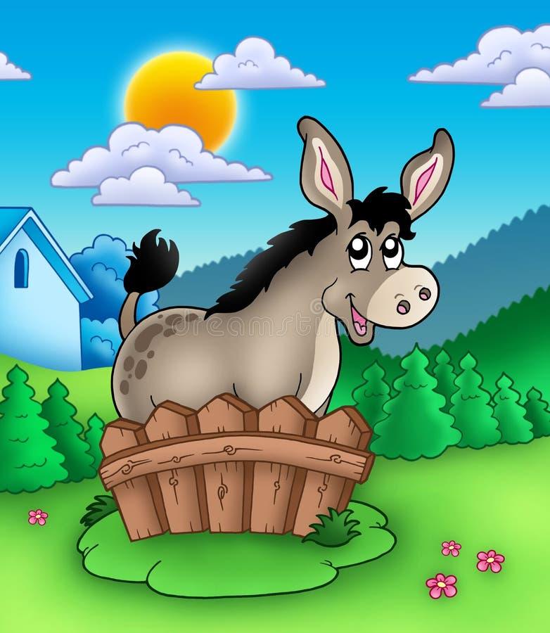 Netter Esel hinter Zaun lizenzfreie abbildung