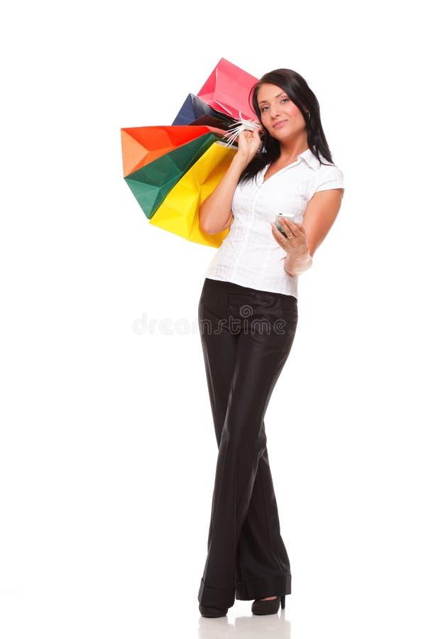 Download Netter Handy Der Jungen Frau Beim Anhalten Von Einkaufstasche Stockfoto - Bild von glücklich, kaukasisch: 27732064