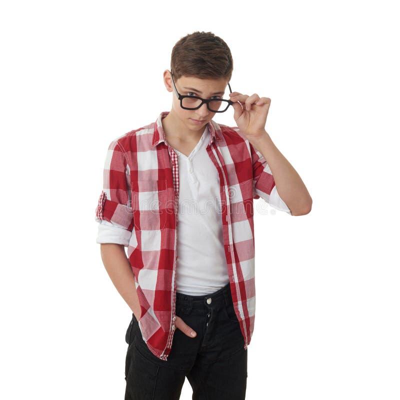 Netter Jugendlichjunge über weißem Hintergrund lizenzfreies stockbild