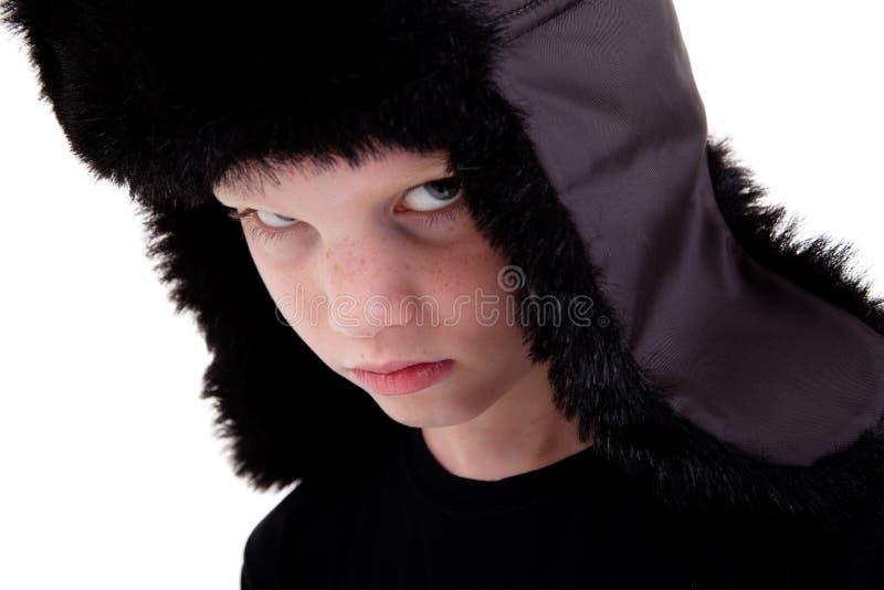 Netter Junge mit einer Schutzkappe, gebohrt stockfoto