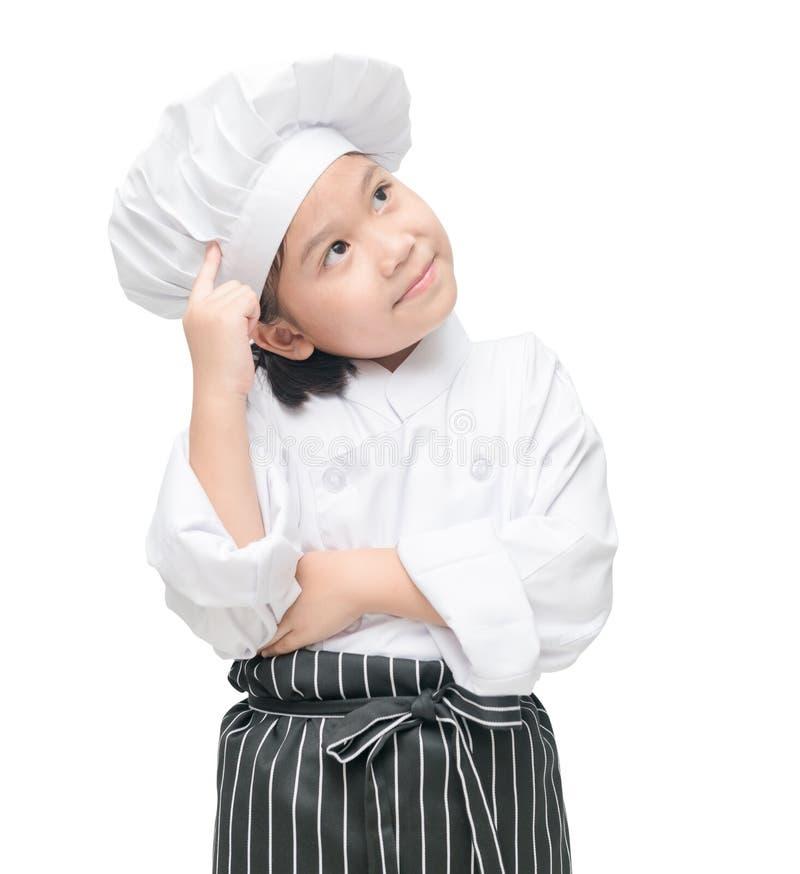 Netter kleiner Chef denkt neues Menü stockbilder