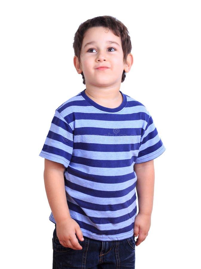 Netter kleiner Junge, der, lokalisiert auf Weiß Gesicht verzieht Gefühle, Gefühle lizenzfreie stockbilder